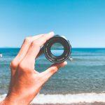 Looking at beach through camera lens